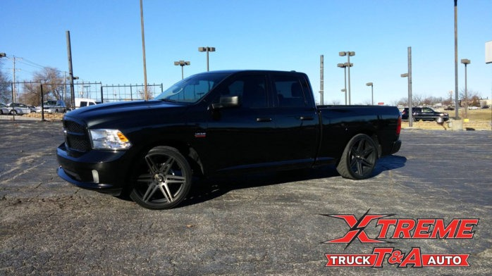 2016 RAM 1500 with a Belltech 2-4 lowering kit 24 Dub Skillz and Nitto 420s tires