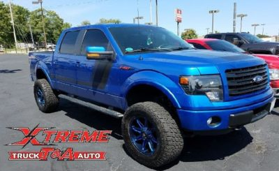 2014 F-150 with 6 Rough Country Lift Custom Painted 20 Mayhem Wheels 35 Nitto Terra Grappler Tires, and Window Tint 1