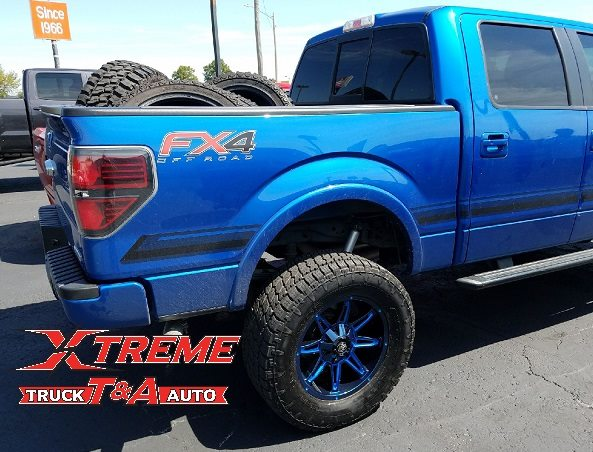 2014 F-150 with 6 Rough Country Lift Custom Painted 20 Mayhem Wheels 35 Nitto Terra Grappler Tires, and Window Tint