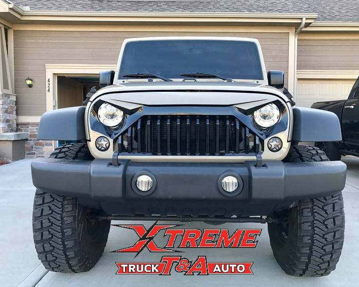 Just added Custom Painted Grille Westin HDX Steps Window Tint and Backup Camera to this 2017 Jeep JK with a 4 Lift on 37 Tires