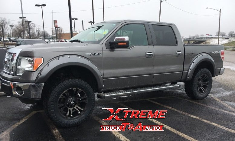 Upfitted this F150 with a 3.5 Readylift Suspension kit Tire